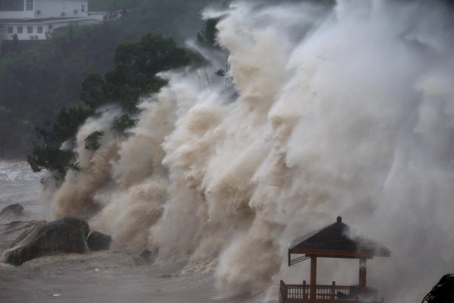 Waves brought by Typhoon Maria lash the shore in Wenzhou, Zhejiang province, China July 11, 2018. (Photo by Ke Zongqing/CNS via Reuters)