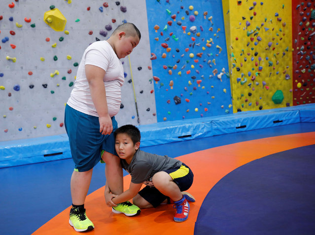 Kyuta Kumagai, 10, wrestles with a boy the same age as him, during a training session at Buddy acL Ariake's wrestling club in Tokyo, Japan, August 22, 2020. (Photo by Kim Kyung-Hoon/Reuters)