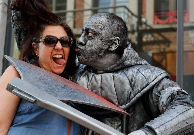 "An artist called ""Le Bourreau/The Headsman"" takes part in the festival ""Statues en Marche"" in Marche-en-Famenne, Belgium, July 22, 2018. (Photo by Yves Herman/Reuters)"