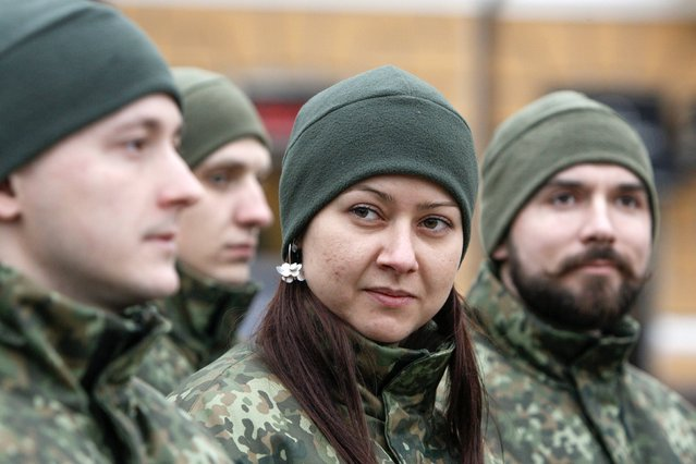 """Members of the newly created Ukrainian interior ministry battalion """"Saint Maria"""" take part in a ceremony before heading to military training, in front of St. Sophia Cathedral, in Kiev, February 3, 2015. Members of the battalion will be sent to the frontline in eastern regions of Ukraine shortly after the training, according to their commander. (Photo by Valentyn Ogirenko/Reuters)"""