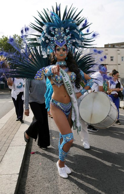 Revellers take part in the Notting Hill Carnival in London, Britain on August 27, 2018. (Photo by South West News Service)