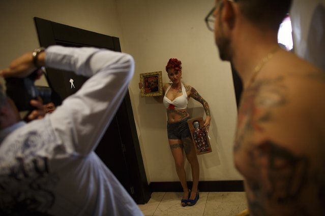 Lucia Moreno, 28, poses for a photographer after winning a Miss Tattoo contest during a tattoo convention in the Andalusian capital of Seville February 14, 2015. (Photo by Marcelo del Pozo/Reuters)