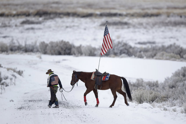 Cowboy Dwane Ehmer, of Irrigon, Ore., a supporter of the group occupying the Malheur National Wildlife Refuge, walks his horse Thursday, January 7, 2016, near Burns, Ore. The group has said repeatedly that local people should control federal lands, but critics say the lands are already managed to help everyone from ranchers to recreationalists. (Photo by Rick Bowmer/AP Photo)