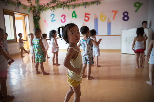 Employees children take part in a music and dance lesson at a kindergarten in the Kim Jong Suk Silk Factory on August 21, 2018 in Pyongyang, North Korea. (Photo by Carl Court/Getty Images)