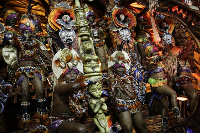 Performers from the Beija Flor samba school, parade on a float during Carnival celebrations at the Sambadrome in Rio de Janeiro, Brazil, Tuesday, February 17, 2015. (Photo by Felipe Dana/AP Photo)