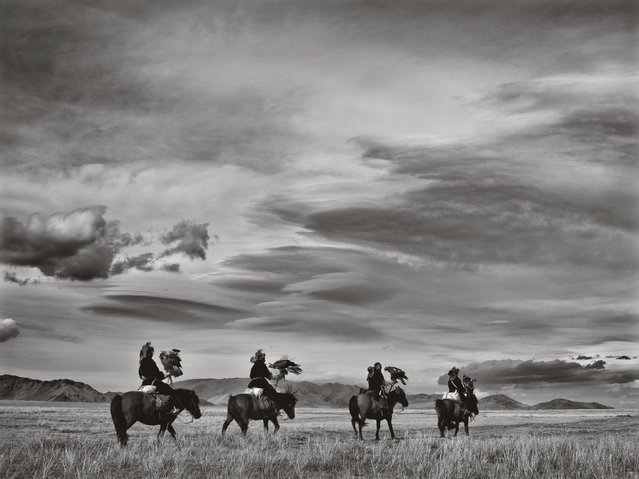 In this undated photo, hunters with their eagles go out on horseback. (Photo by Palani Mohan)
