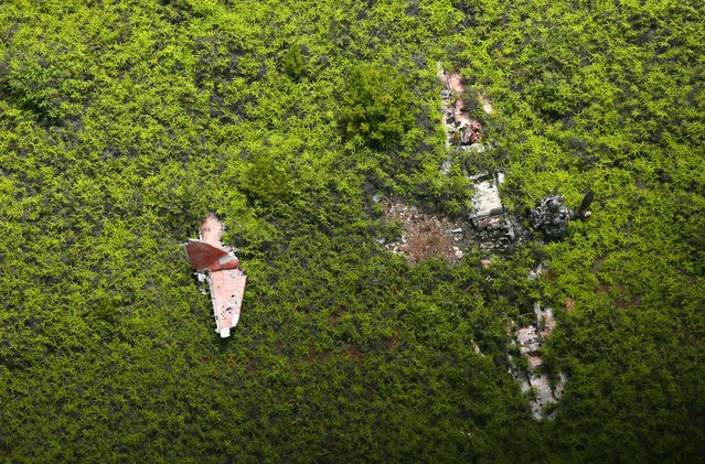 "In this aerial image, debris of the Japanese Imperial Navy fighter A6M ""Zero"" is seen in the field on August 29, 2016 in Babeldaob Island, Palau. (Photo by The Asahi Shimbun via Getty Images)"