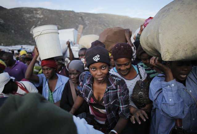 Haitians push to cross the border between the Dominican Republic and Haiti in Malpasse, Haiti March 12, 2015.Haitians regularly cross to the Dominican Republic every Monday and Thursday to buy goods. (Photo by Andres Martinez Casares/Reuters)