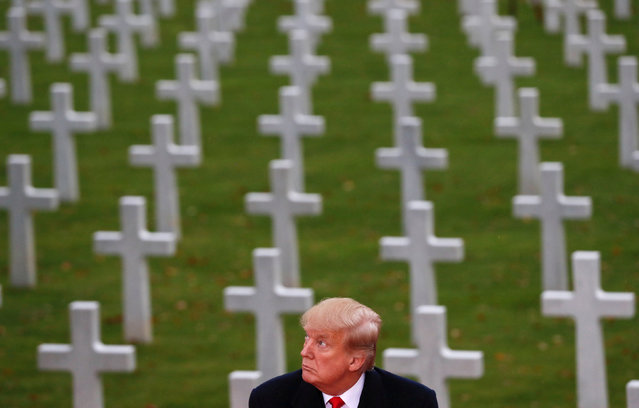 U.S. President Donald Trump takes part in the commemoration ceremony for Armistice Day, 100 years after the end of World War One, at the Suresnes American Cemetery and Memorial in Paris, France, November 11, 2018. (Photo by Carlos Barria/Reuters)