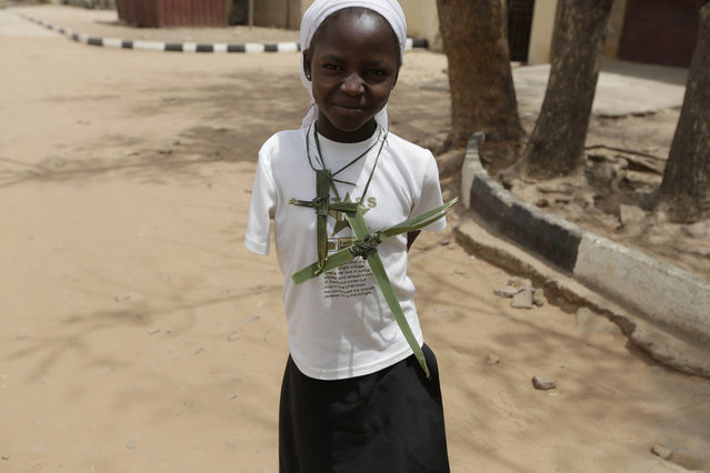 A Nigerian girl, poses for a photograph on Palm Sunday, outside St Theresa's Catholic Church, in Yola,  Nigeria. Sunday, March 29, 2015. (Photo by Sunday Alamba/AP Photo)