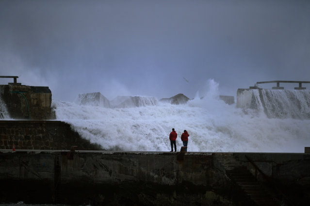 Representatives from the Basque regional government observe damage to a sea wall caused by huge waves at the port of Bermeo, northern Spain February 9, 2016. (Photo by Vincent West/Reuters)