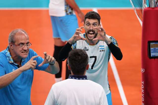 Head coach Marcelo Rodolfo Mendez (L) and Facundo Conte (R) of Argentina argue with the referee in the third set of the men's seminfinal match between Argentina and France of the Volleyball events of the Tokyo 2020 Olympic Games, at Ariake Arena in Tokyo, Japan, 05 August 2021. (Photo by Michael Reynolds/EPA/EFE)