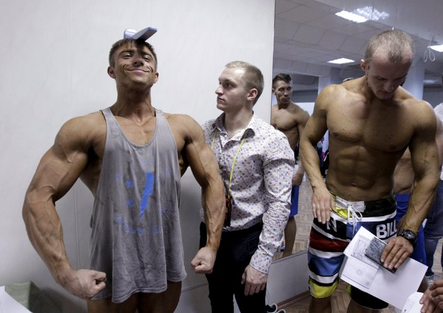 Participants prepare backstage during a regional bodybuilding and fitness competition in Stavropol, southern Russia April 4, 2015. (Photo by Eduard Korniyenko/Reuters)
