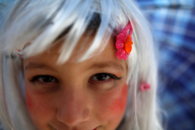 A reveller poses for the camera while participating in a parade on the streets during a carnival to mark the annual Orthodox St. Vasilij Day in the village of Vevcani, south of the Macedonian capital of Skopje, January 13, 2017. (Photo by Ognen Teofilovski/Reuters)