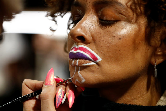 A model has her makeup done for the Maybelline New York show ahead of the Berlin Fashion Week Autumn/Winter 2017 in Berlin, Germany, January 16, 2017. (Photo by Fabrizio Bensch/Reuters)