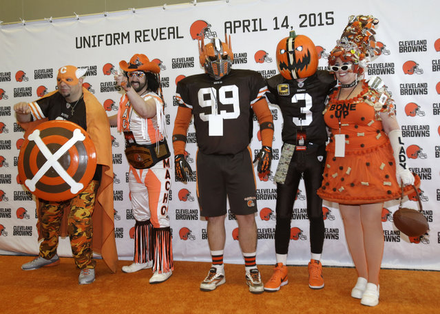 Cleveland Browns fans pose for pictures on the orange carpet before the unveiling of the new uniforms Tuesday, April 14, 2015, in Cleveland. After two years of planning and months of speculation and secrecy, the Browns unveiled new uniforms they hope will be a big hit with Cleveland fans. (Photo by Tony Dejak/AP Photo)