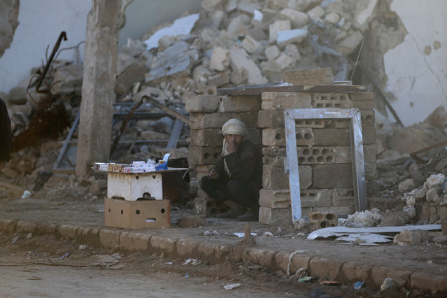 A man sells cigarettes near rubble of damaged buildings in al-Rai town, northern Aleppo countryside, Syria January 13, 2017. (Photo by Khalil Ashawi/Reuters)