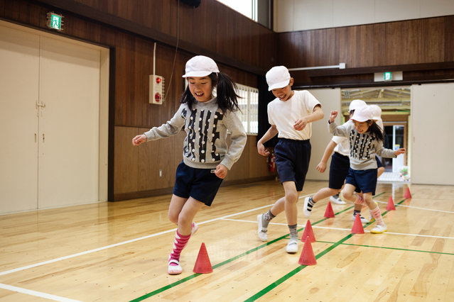 Students at physical education at Aone elementary school gym on April 9, 2015. (Photo by Ko Sasaki/The Washington Post)