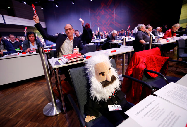 A Karl Marx puppet is placed on a seat while delegates of a three day party congress of Germany's left-wing party Die Linke vote in Bonn, Germany February 22, 2019. (Photo by Wolfgang Rattay/Reuters)