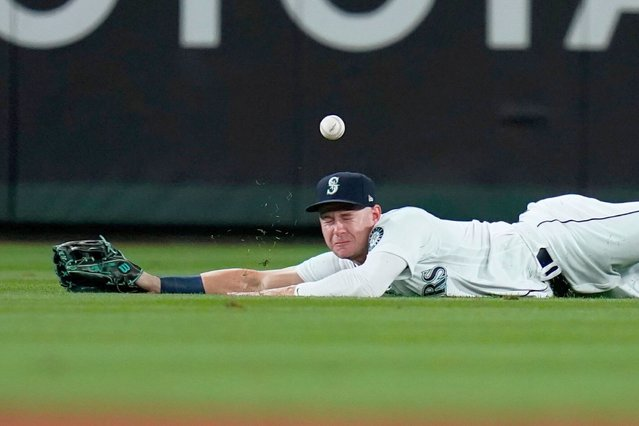 Seattle Mariners center fielder Jarred Kelenic dives for but misses the ball on a single by Boston Red Sox's Jose Iglesias during the fifth inning of a baseball game Tuesday, September 14, 2021, in Seattle. (Photo by Elaine Thompson/AP Photo)