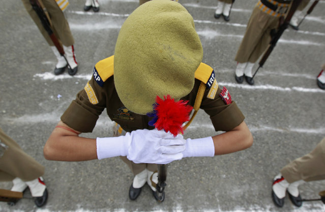 A female Indian police officer bows her head during a ceremony to mark Police Commemoration Day in Zewan, in the outskirts of Srinagar October 21, 2012. (Photo by Fayaz Kabli/Reuters)