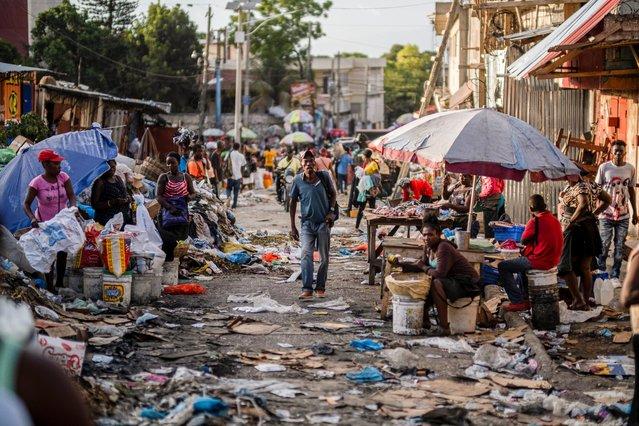 A man walks through a Petion-Ville street market in Port-au-Prince, Haiti on July 18, 2021. (Photo by Ricardo Arduengo/Reuters)