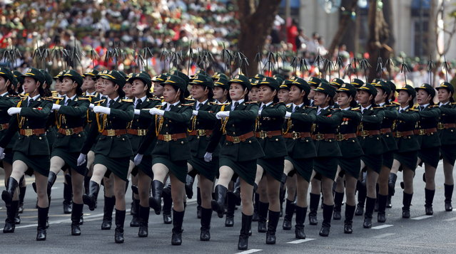 Vietnamese female Commissioned Officers of the Signal Force march during a military parade as part of the 40th anniversary of the fall of Saigon in Ho Chi Minh City (formerly Saigon), Vietnam, April 30, 2015. Vietnam marked the 40th anniversary of the capture of Saigon by North Vietnamese forces on April 30, the event that ended a war that lasted 30 years. (Photo by Reuters/Kham)