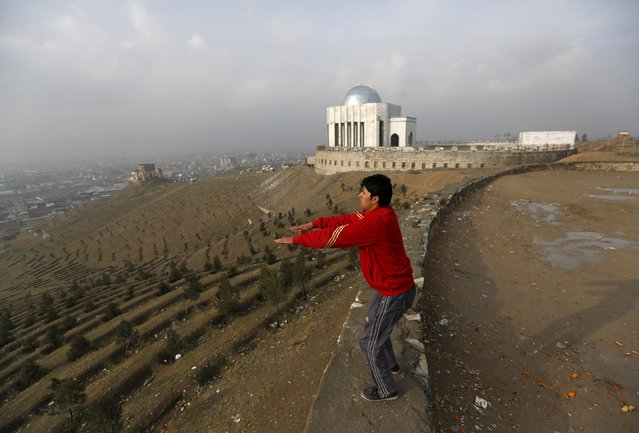 A man exercises in the early morning on a hilltop overlooking Kabul, Afghanistan March 3, 2016. (Photo by Mohammad Ismail/Reuters)