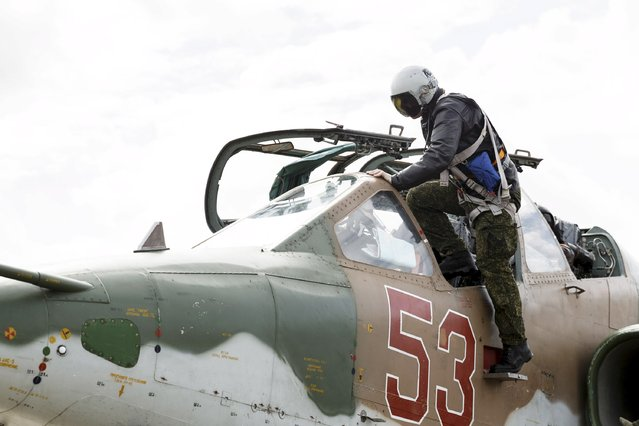 A Russian pilot gets inside a Sukhoi Su-25 fighter jet shortly before the take-off, part of the withdrawal of Russian troops from Syria, at Hmeymim airbase, Syria, March 15, 2016. (Photo by Vadim Grishankin/Reuters/Russian Ministry of Defence)