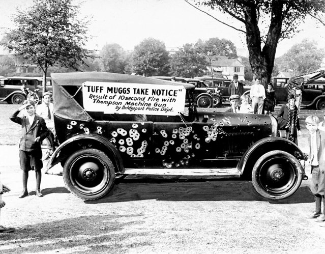 Police and Fireman's Day display of a gangster's car riddled by Thompson machine guns for ten seconds on September 24, 1930. (Photo by Leroy Jakob/NY Daily News Archive via Getty Images)