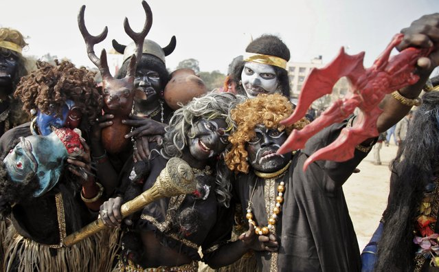 Hindu devotees dressed as demons participate in a procession on the eve of Shivratri festival, in Jammu, India, Wednesday, February 26, 2014. (Photo by Channi Anand/AP Photo)
