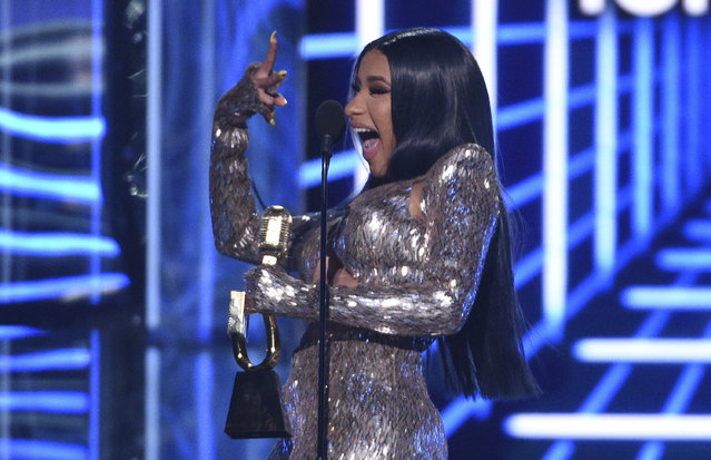 "Cardi B gestures as she accepts the top rap song award for ""I Like It"" at the Billboard Music Awards on Wednesday, May 1, 2019, at the MGM Grand Garden Arena in Las Vegas. (Photo by Chris Pizzello/Invision/AP Photo)"