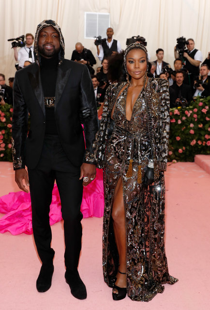 "Dwyane Wade and Gabrielle Union attend the 2019 Met Gala celebrating ""Camp: Notes on Fashion"" at the Metropolitan Museum of Art on May 06, 2019 in New York City. (Photo by Andrew Kelly/Reuters)"