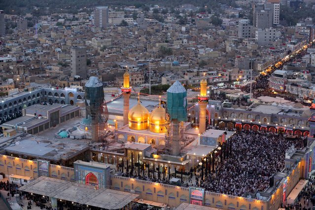 An aerial view of the holy Muslim Shiite shrine of Imam Moussa al-Kazim as pilgrims gather to commemorate his death, in the Shiite district of Kazimiyah, Baghdad, Iraq, Wednesday, May 13, 2015. (Photo by Hadi Mizban/AP Photo)