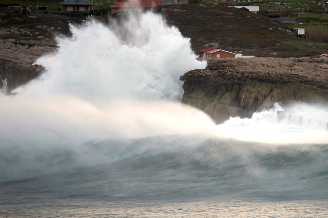 A huge wave hits the Cuchia cliff in the village of Suances, region of Cantabria, Spain, 28 March 2016. Spanish authorities alerted that heavy winds will hit the northern coast of Spain. (Photo by Pedro Puente Hoyos/EPA)