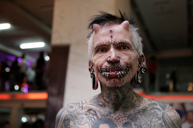 Rolf Buchholz, the most pierced man in the world according to Guinness World Records, poses for a photograph as he takes part in Expo Tattoo Venezuela in Caracas, Venezuela February 17, 2017. (Photo by Marco Bello/Reuters)