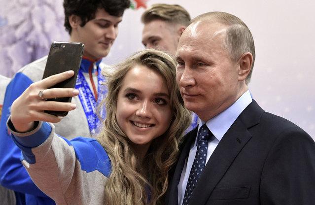 President Vladimir Putin, right, poses for a selfie during a visit to the Academy of Biathlon in Krasnoyarsk, Russia on Wednesday, March 1, 2017. (Photo by Alexei Nikolsky/Sputnik, Kremlin Pool Photo via AP Photo)