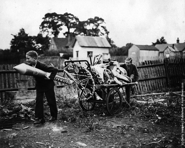 1930: Two boys pulling a cartload of fireworks home in preparation for November 5th, Guy Fawkes night
