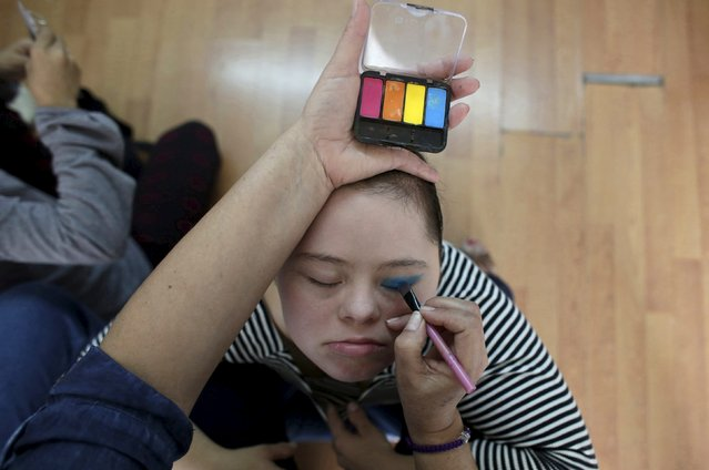 Aimee, 19, who has Down syndrome, has make-up applied by her mother before a presentation in Monterrey, Mexico, in this picture taken April 9, 2016. (Photo by Daniel Becerril/Reuters)