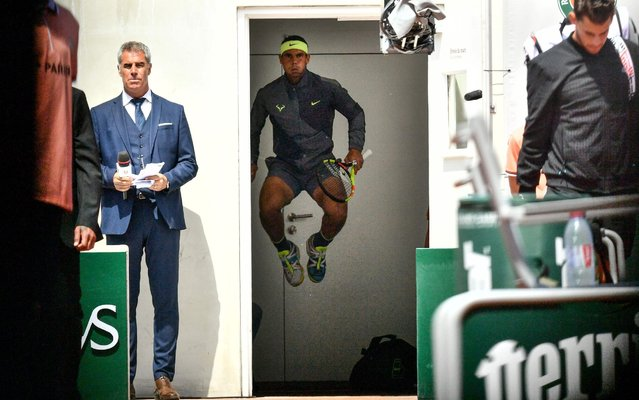 Spain's Rafael Nadal jumps and warms up before entering the tennis court prior to his men's singles final match against Austria's Dominic Thiem on day fifteen of The Roland Garros 2019 French Open tennis tournament in Paris on June 9, 2019. (Photo by Philippe Lopez/AFP Photo)