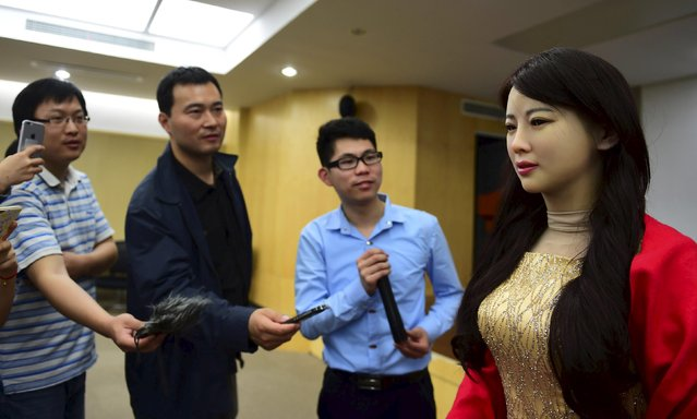 Humanoid robot Jiajia produced by University of Science and Technology of China answers reporters' questions, at a launch event in Hefei, Anhui province, April 15, 2016. (Photo by Reuters/Stringer)