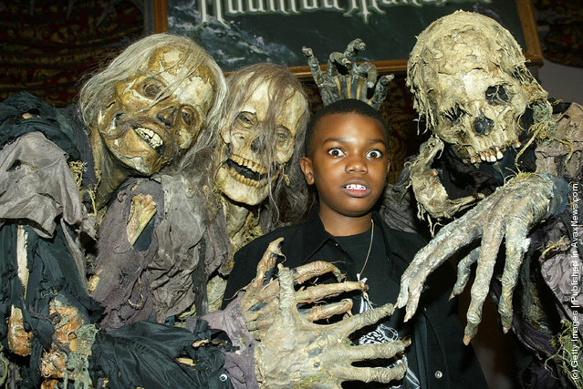 Actor Marc John Jeffries poses with ghouls