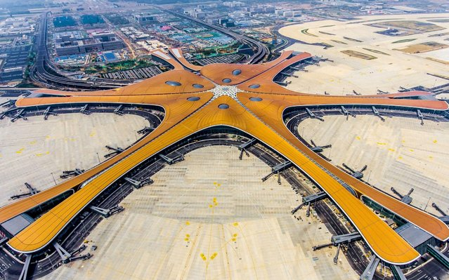 This photo taken on June 28, 2019 shows the terminal of the new Beijing Daxing International Airport. Beijing is set to open an eye-catching multi-billion dollar airport resembling a massive shining starfish, to accommodate soaring air traffic in China and celebrate the Communist government's 70th anniversary in power. (Photo by AFP Photo/China Stringer Network)