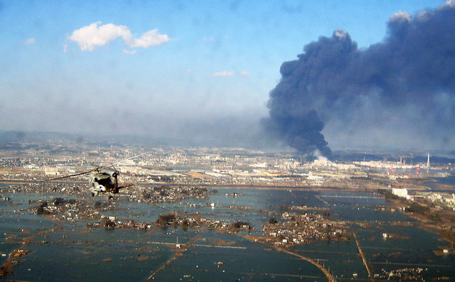 In this handout image provided by U.S. Navy, an aerial view of tsunami and earthquake damage is seen from an SH-60B helicopter assigned to the Chargers of Helicopter Antisubmarine Squadron (HS) 14 from Naval Air Facility Atsugi March 12, 2011 seen from the air of Sendai, Japan. An earthquake measuring 8.9 on the Richter scale has hit the northeast coast of Japan causing tsunami alerts throughout countries bordering the Pacific Ocean. (Photo by U.S. Navy via Getty Images)