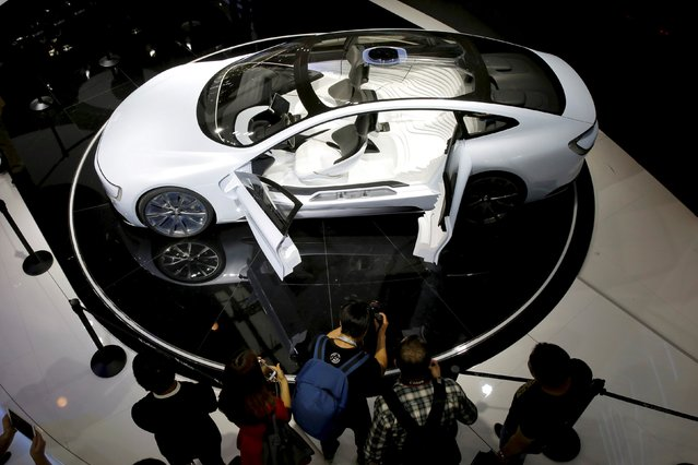 Visitors look at all-electric battery concept car called LeSEE during Auto China 2016 auto show in Beijing, April 25, 2016. (Photo by Kim Kyung-Hoon/Reuters)