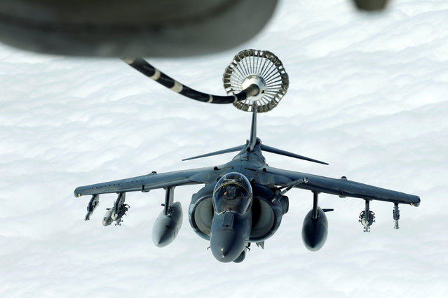 A US Marines Harrier AV-8B makes its way to a fueling boom suspended from a US Air Force KC-10 Extender during mid-air refueling support to Operation Inherent Resolve over Iraq and Syria air space, March 15, 2017. (Photo by Hamad I Mohammed/Reuters)