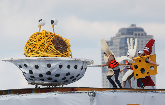 Participants from the Pastafarians team perform during the Red Bull Flugtag Russia 2019 competition in Moscow, Russia, July 28, 2019. (Photo by Maxim Shemetov/Reuters)