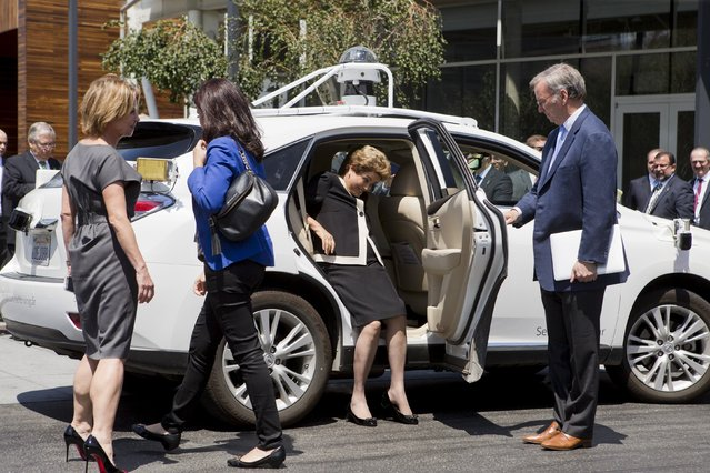 Google Executive Chairman Eric Schmidt (R) holds the door open as Brazil President Dilma Rousseff (2nd R) takes a seat in a self-driving car at Google Headquarters in Mountain View, California, July 1, 2015. (Photo by Beck Diefenbach/Reuters)