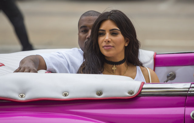 American reality-show star Kim Kardashian West and her husband, rap superstar,  Kayne West  ride on a classic car in Havana, Cuba, Wednesday, May 4, 2016. (Photo by Desmond Boylan/AP Photo)