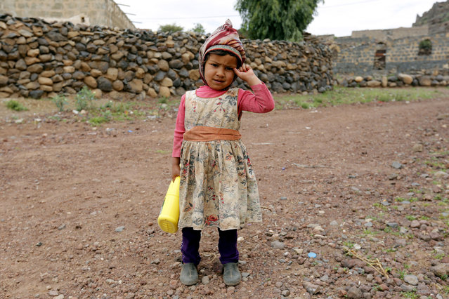 A conflict-ridden Yemeni child holds a plastic bottle of cooking oil provided by Mona Relief Yemen at a village on the outskirts of Sana'a, Yemen, 27 August 2019. The ongoing conflict in Yemen since 2015 has created the worst humanitarian crisis in the world, where some 80 percent of Yemen's 26-million population are in need of humanitarian assistance. (Photo by Yahya Arhab/EPA/EFE)
